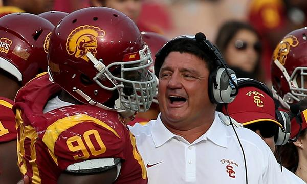 USC interim coach Ed Orgeron hugs defensive end George Uko during Saturday's win over Utah. The Trojans hope to win again Friday at Oregon State.