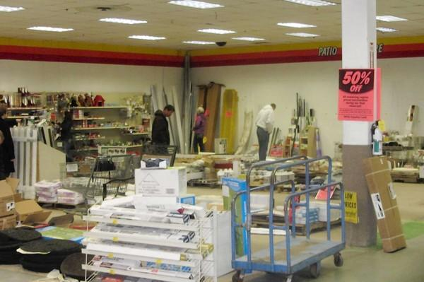 Shoppers at a Menards in Mundelein browse the store's remaining inventory as signs advertise a going-out-of business sale. The Oak Creek Plaza store on Route 60 closed Oct. 18 to make room for a potential Wal-Mart.