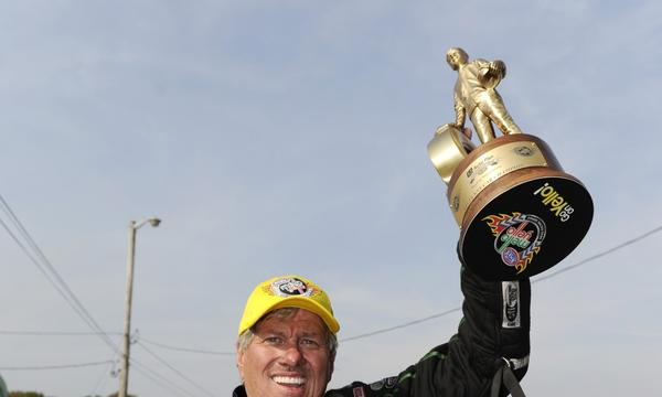Drag-racing legend John Force won his 16th NHRA funny car title Sunday.