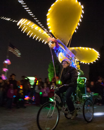 Designs like this kinetic buttery attached to a bicycle and others moved down the parade route. The annual Halloween Lantern Parade through Patterson Park featured costumes, music, food trucks and other performances.