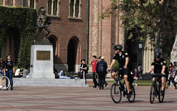 USC Department of Public Safety officers on bikes patrol on campus the day after several young men were shot at a Halloween party there.