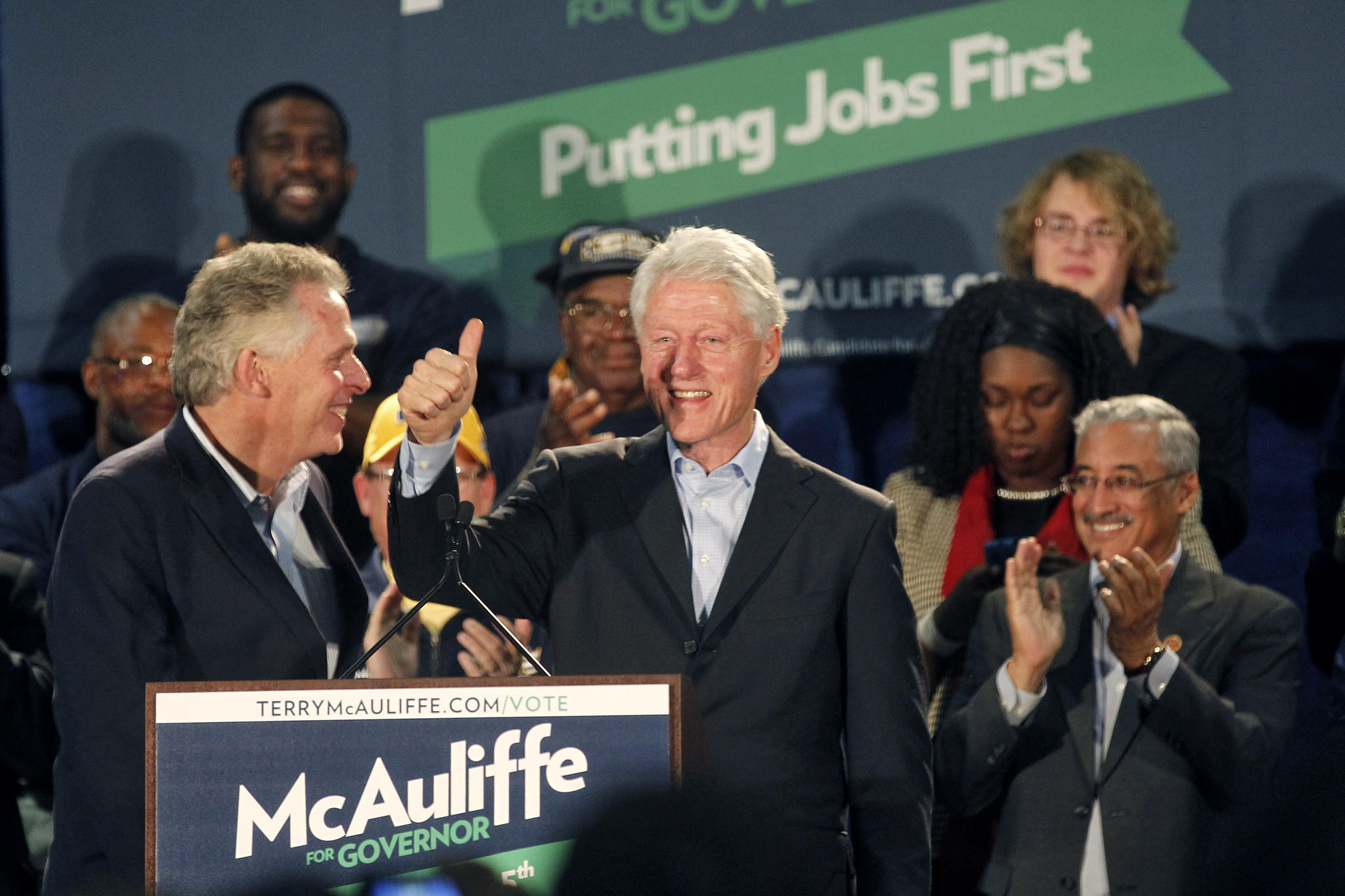 Former President Bill Clinton speaks during an event with Democratic gubernatorial candidate Terry McAuliffe Sunday evening at the Y.H. Thomas Community Center in Hampton.