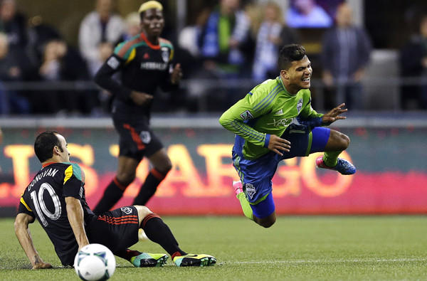 Galaxy midfielder Landon Donovan sends the Sounders' DeAndre Yedlin flying with a sliding tackle in the first half Sunday.