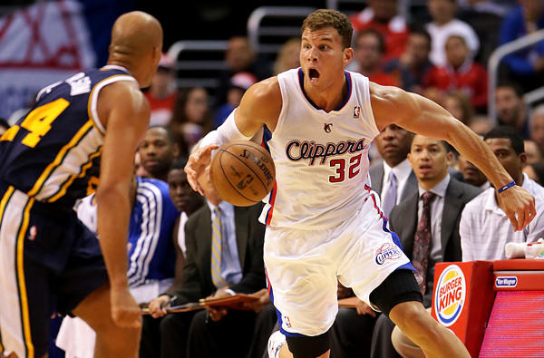 Clippers power forward Blake Griffin brings the ball upcourt against Utah Jazz forward Richard Jefferson during a preseason game at Staples Center.