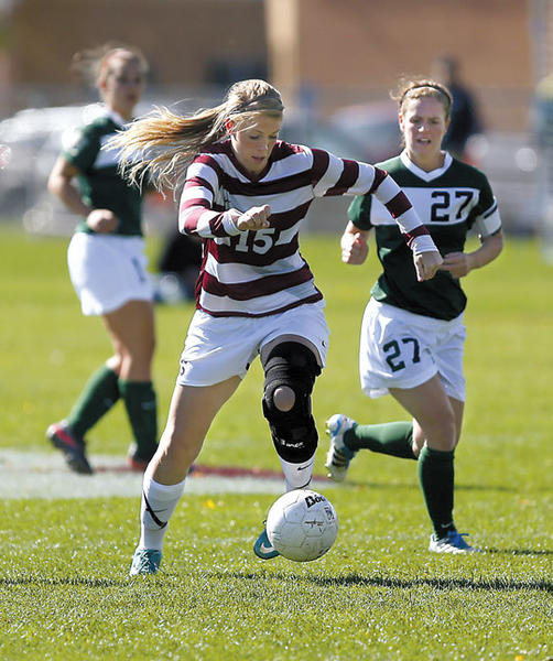 Northern State University's Hilary Peterson, left, pushes the ball up the pitch ahead of Bemidji State's Maria McLeod (27) during Saturday's game at Jerde Field. photo by john davis taken 10/12/2013