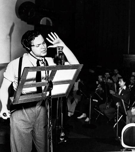 "Orson Welles reads from his script during the 1938 broadcast of his radio show ""The War of the Worlds."""
