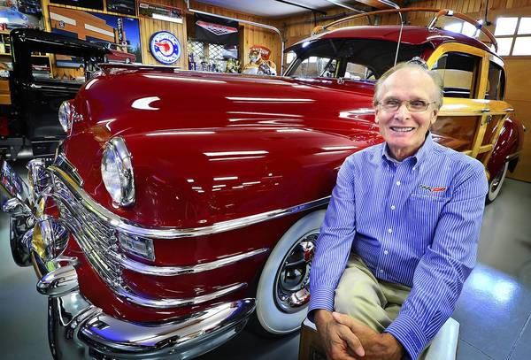 Loren Hulber, a prominent investor in antique cars, with his 1947 Chrysler Town & Country in his garage in Upper Milford.