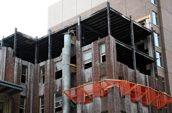 Bricks have been removed during restoration work at the Dime Bank at the Allentown arena site.