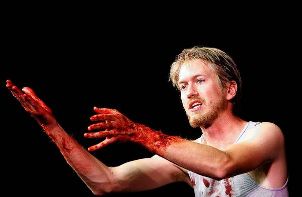 Actor Brandon Meeks, on stage portraying Macbeth, during a performance in the 2013 Linny Fowler WillPower Tour, at the Labuda Center for the Performing Arts on the campus of DeSales University.