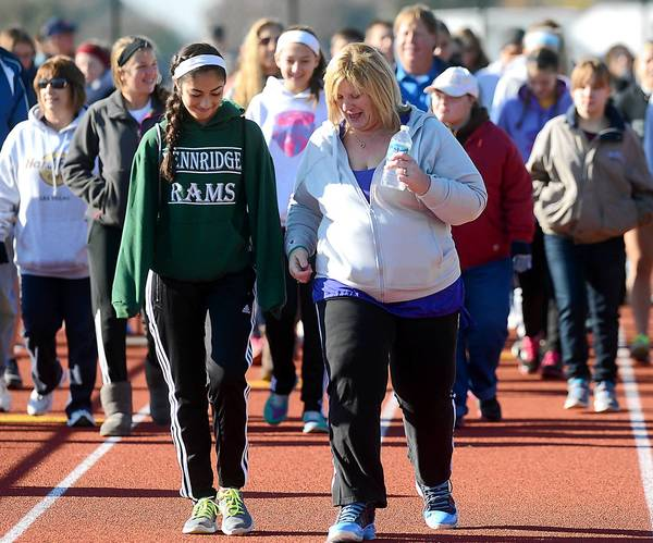 Loren Volpe (left), a 10th-grade student at Pennridge High School, takes part in the 'Do It For Matt' walkathon. With Volpe is Kathy Leavens of Telford. Leavens' son, Matt, died of epilepsy, and Saturday's event was a fundraiser to defray the cost of a headstone for Matt's grave.