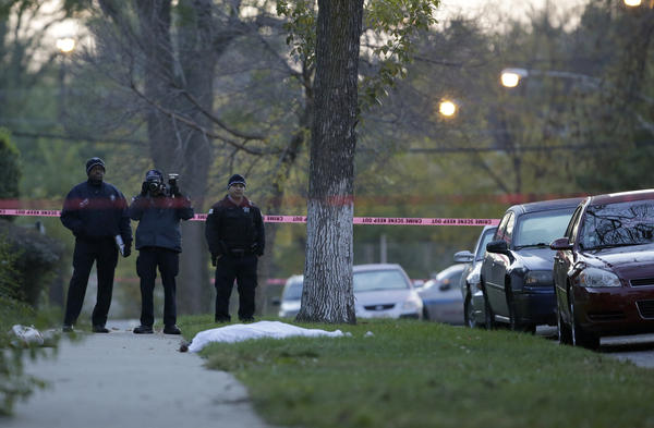 Police conduct a death investigation on the 1200 block of West 72nd Place early Monday.