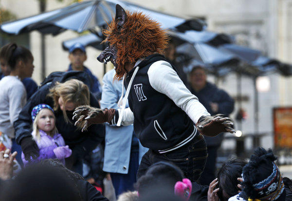 "A member of performance group called f.c.b.c (For Children By Children) of Chicago re-enact Michael Jackson's ""Thriller"" video during a Halloween event at the Daley Plaza on Sunday."