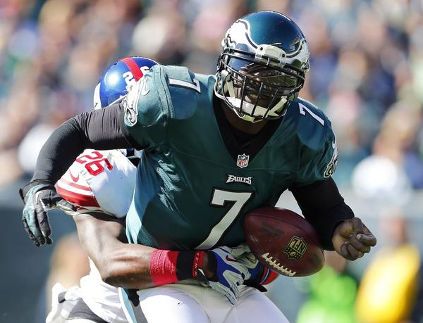 Quarterback Michael Vick of the Philadelphia Eagles fumbles as he is sacked by safety Antrel Rolle of the New York Giants during the first quarter of a game at Lincoln Financial Field.