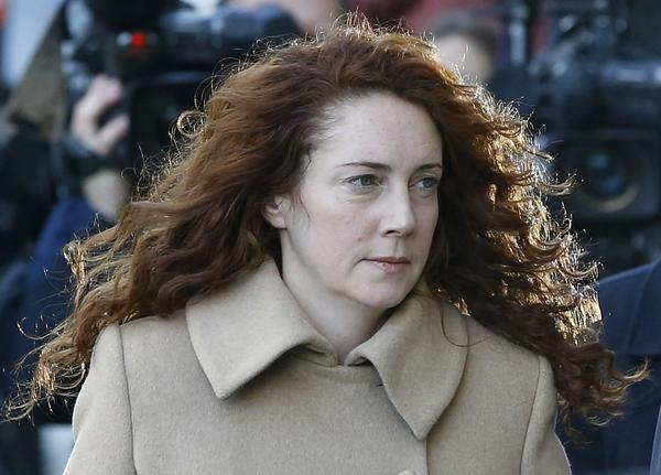 Rebekah Brooks arrives at the Old Bailey law court in London on Monday, when a trial opened against Brooks and seven others into charges stemming from a phone hacking scandal at Rupert Murdoch's News of the World tabloid.