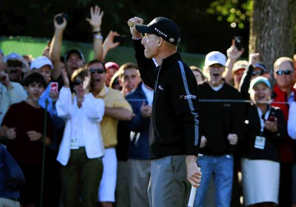 The BMW Championship in Lake Forest attracted more than 134,000 visitors. A crowd watches Jim Furyk on Sept. 13 in the second round of the tournament at Conway Farms Golf Club.