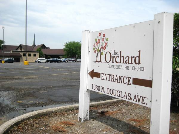 Orchard Evangelical Free Church drops plan to build surface parking lot in Arlington Heights. Instead it will try valet service, re-launch a shuttle program and have volunteers direct two-way traffic.
