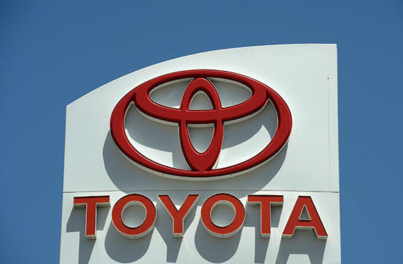 The Toyota logo is seen on a sign at a North Hollywood dealership on May 9, 2012 in Los Angeles.