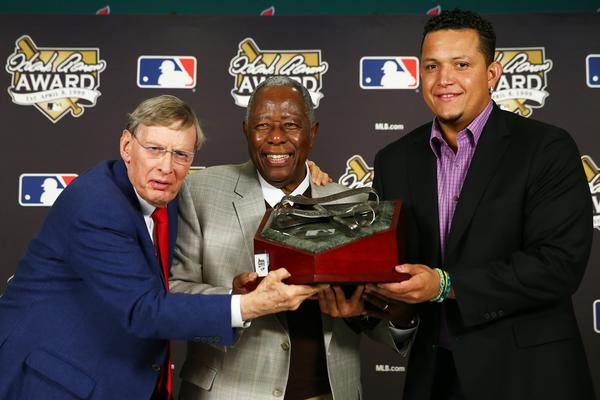 Major League Baseball Commissioner Allan 'Bud' Selig, retired American professional baseball player Hank Aaron and 2013 honouree Miguel Cabrera of the Detroit Tigers pose during the 2013 Hank Aaron Award press conference prior Game Four of the 2013 World Series between the Boston Red Sox and the St. Louis Cardinals at Busch Stadium on October 27, 2013 in St Louis, Missouri. Paul Goldschmidt of the Arizona Diamondbacks was also honered with the award.