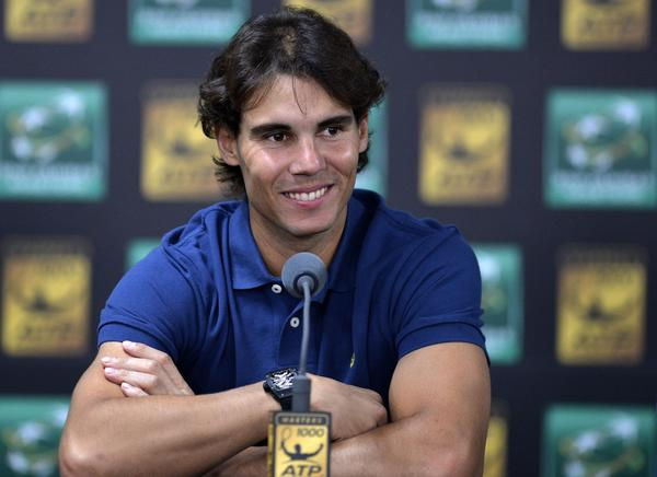 Spain's Rafael Nadal smiles during a press conference at the ninth and final ATP World Tour Masters 1000 indoor tennis tournament on October 28, 2013 at the Bercy Palais-Omnisport