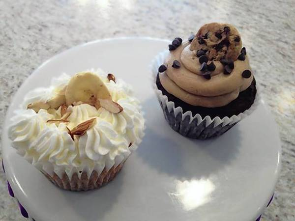 A banana cream pie cupcake and a cookie dough cupcake.