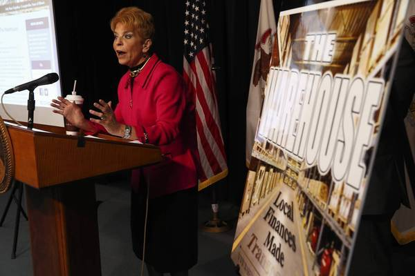 Illinois Comptroller Judy Barr Topinka introduces the launch of The Warehouse, a comprehensive online database that puts local governmental financial information and tens of thousands of records at a single location for taxpayer review during a press conference at the Thompson Center.