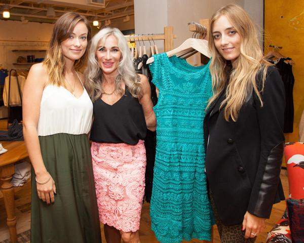 Olivia Wilde, left, with designer Yoana Baraschi and Barbara Burchfield showing off the New Light dress in turquoise.