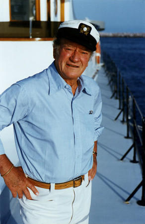 John Wayne is shown aboard his boat, the Wild Goose, in 1977.