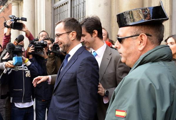 U.S. Ambassador to Spain James Costos, left, leaves the Spanish Foreign Ministry in Madrid.