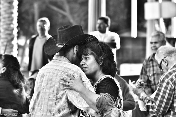 A couple dances in the Olvera Street Plaza.
