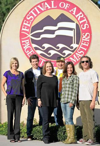 From left, Michelle Ray, development director at the Boys & Girls Club of Laguna Beach; Tyler Russell, KX 93.5 founder; Susan Davis, director of special events at the Festival of Arts; Bobby Serna, surf experience director at Mauli Ola Foundation; Kim Novick, development director at the Tony Hawk Foundation; and Jason Feddy, KX 93.5 midday host, pose for a photo at the Festival of Arts and Pageant of the Masters in Laguna Beach on Wednesday. Feddy will be the emcee for the first Festival of Music event in Laguna Beach.