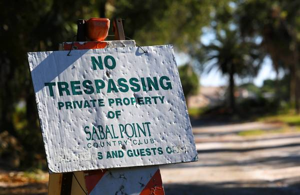 A no trespassing sign marks what used to be the entrance at the former Sabal Palm Country Club clubhouse, in Longwood, Friday, October 25, 2013. The course closed in 2006 and is now under consideration for new development.