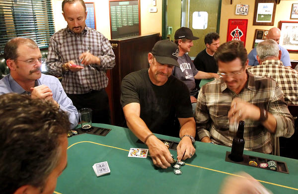 "NewportMesa team captain John ""Nuke"" Cornuke, for whom Team Nuclear is named, pulls a big pot during Movember poker fundraiser at the Newport Rib Co. last year."