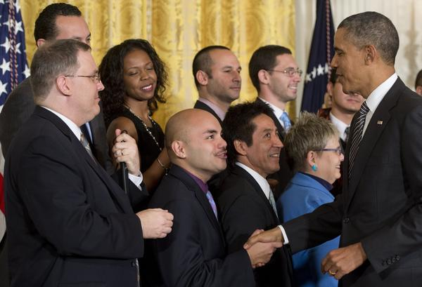 President Obama greets supporters after speaking about immigration reform in the East Room of the White House last week.