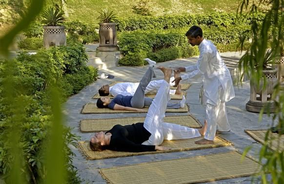 Morning yoga on the Ananda grounds. Guests are identified by body and behavior type. This governs the diet, meditation and exercise that the spa recommends.