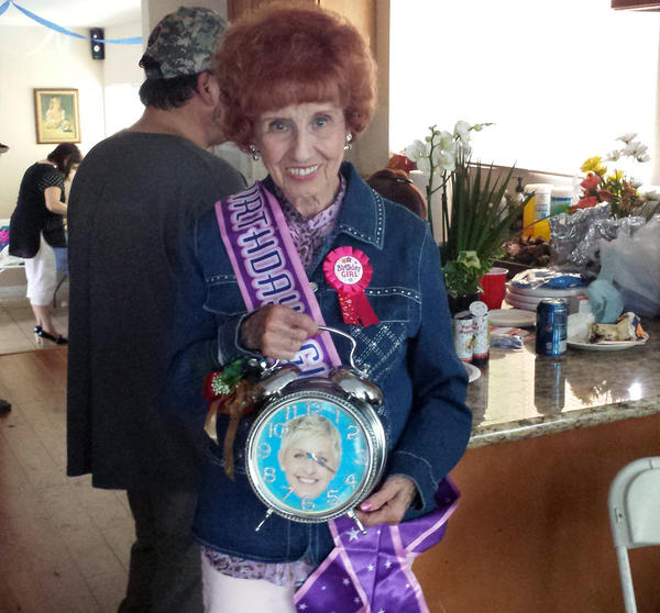 "Elinor Otto, a ""Rosie the Riveter"" who still works for Boeing, at her surprise 94th birthday party with the clock given to her on the ""Ellen"" show."