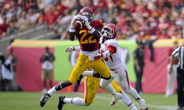 USC safety Leon McQuay III intercepts a pass intended for Utah wide receiver Geoff Norwood, right, during the Trojans' 19-3 win Saturday.