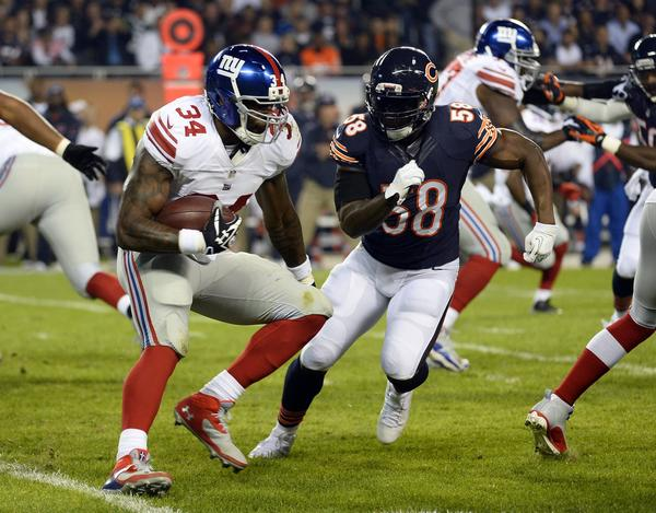 Giants running back Brandon Jacobs tries to elude Bears outside linebacker Khaseem Greene.