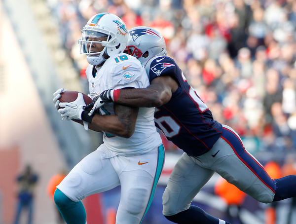 Miami Dolphins wide receiver Rishard Matthews (18) is tackled by New England Patriots cornerback Logan Ryan (26) during the fourth quarter at Gillette Stadium. The Patriots defeated the Dolpins 27-17.