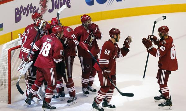 The Phoenix Coyotes celebrate following Saturday's win over the Edmonton Oilers. With a new owner in place, the Coyotes are turning all of their attention back to the ice.