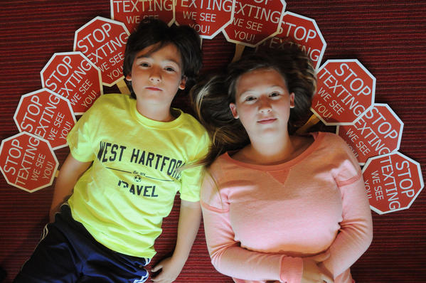 Brother and sister Henry and Olivia Krieble, ages 10 and 12, designed stop texting signs on popsicle sticks and have been handing them out at school and sending them to people in towns and even states that have inquired on their Facebook page. They hope to get the signs in the hands of everyone in the community and eradicate texting and driving for good.