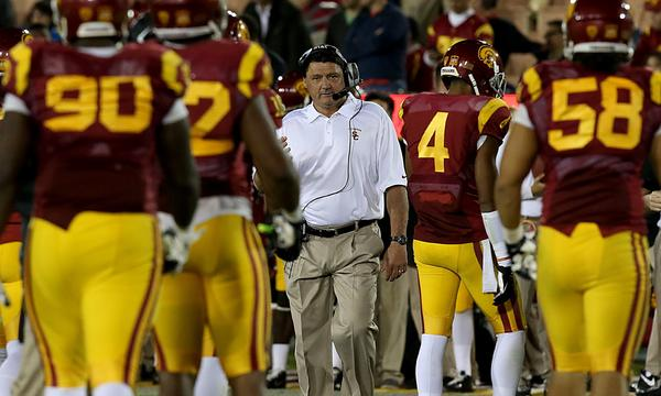 USC Interim Coach Ed Orgeron has had to embrace a somewhat unusual strategy in trying to recruit high school players for a program that is in between head coaches.