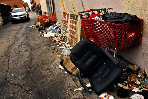 """Debris lines an alley in the Westlake neighborhood, just west of downtown Los Angeles. """"It's like weeds,"""" a sanitation worker said of litter in the area. """"You clear up one alley one day, and the next week — sometimes the next day — it's back to how it was."""""""