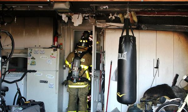 Two teenage boys and a cat escape a smoky fire in the attic of their Deerfield Beach home