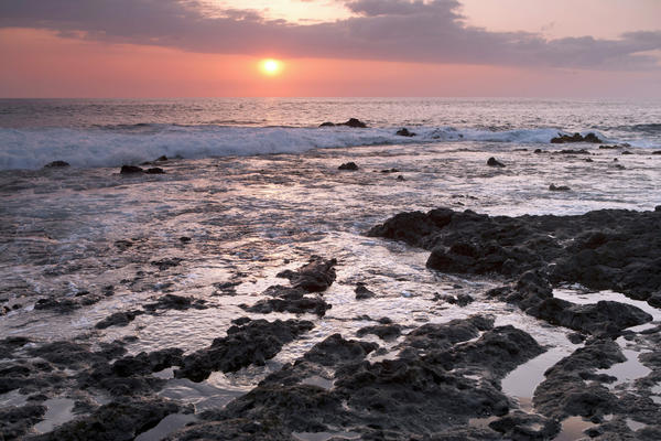 The sun sets at Pahoehoe Beach Park in Kona on the Big Island.