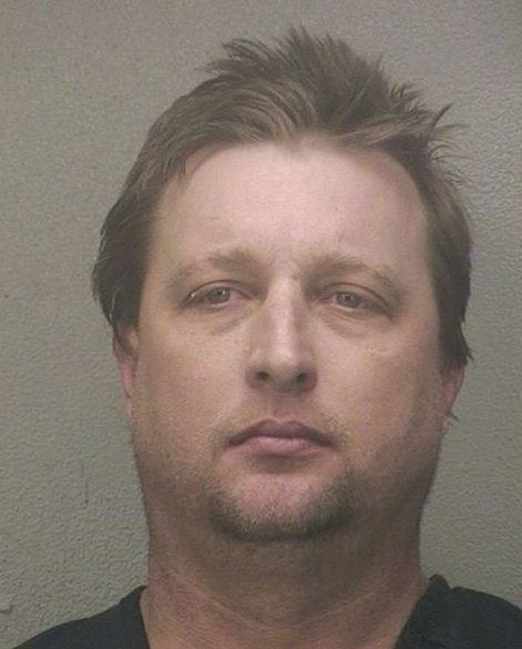 Kenneth Stuart, 41, is accused of attacking his girlfriend with her cat in Davie