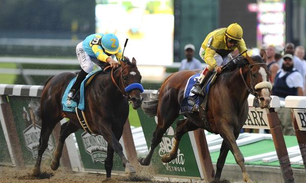 Jockey Mike Smith rides Paynter to a second-place finish in the 2012 Belmont Stakes. Paynter has made a remarkable comeback since suffering a bone fracture at last year's Belmont States.