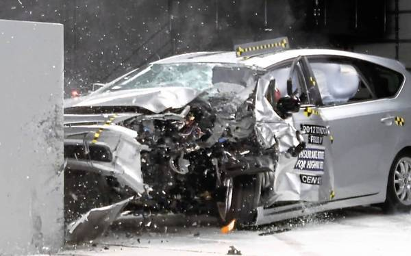 A 2012 Prius V is subjected to a test that simulates a wreck in which a front corner of the car hits another car or a fixed object. The Insurance Institute for Highway Safety gave the vehicle a poor score.
