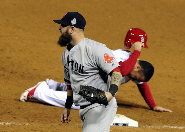 Red Sox first baseman Mike Napoli celebrates picking off Cardinals pinch runner Kolten Wong to end Game 4.