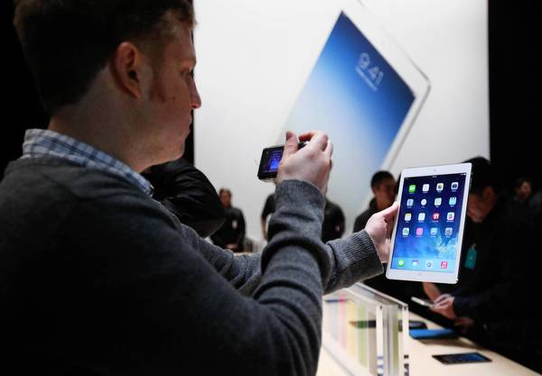 Apple Chief Executive Tim Cook is confident that two new iPad models will turbocharge sales. Above, the unveiling of the devices last week in San Francisco.