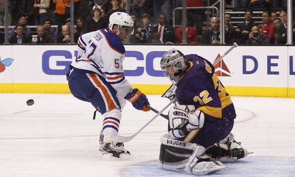 Kings goalie Jonathan Quick, right, makes a shootout save on Edmonton Oilers forward David Perron during the Kings' win Sunday.
